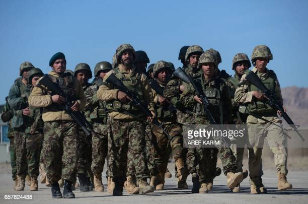 In this photograph taken on February 9 Afghan National Army soldiers march during a training by Italian soldiers from NATO's Resolute Support Mission...