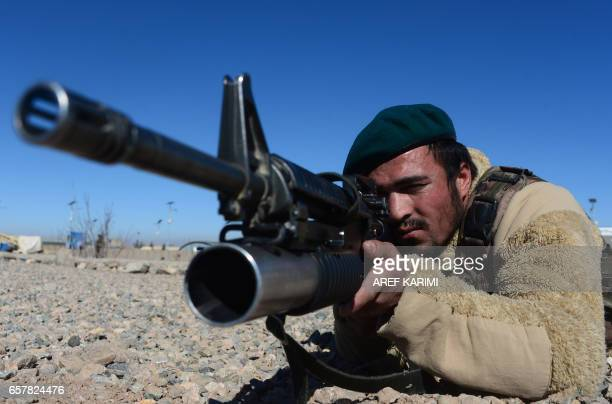 In this photograph taken on February 9 an Afghan National Army soldier looks on during training by Italian soldiers from NATO's Resolute Support...