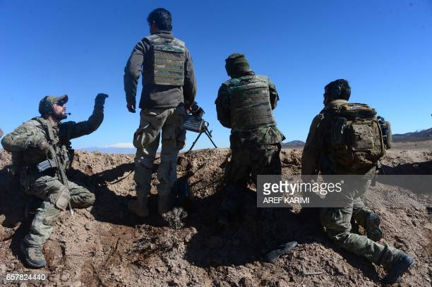In this photograph taken on February 9 an Italian soldier from NATO's Resolute Support Mission trains Afghan National Army soldiers at a Military...