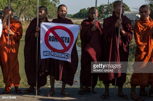 In this photograph taken on February 9 antiRohingya hardline Buddhist monks and supporters rally outside Yangon's Thilawa port as the Malaysian ship...