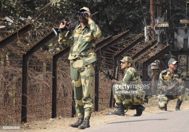 In this photograph taken on February 9 Indian Border Security Force personnel take part in a routine patrol near the IndiaBangladesh border in the...
