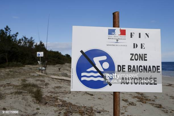 In this photograph taken on February 9 shows a sign on the beach reserved for prisoners at the open prison of Casabianda near Aleria on the French...