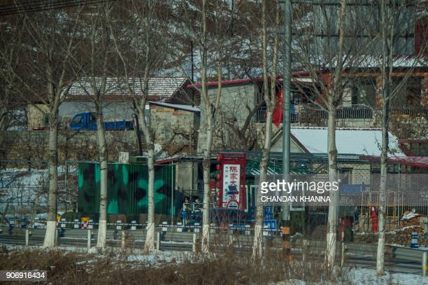 In this photograph taken on January 10 2018 Chinese border security personnel stand guard at a post in Dandong in China's northeast Liaoning province...