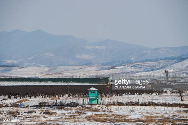 In this photograph taken on January 10, 2018 North Korean soldiers are seen at a guard post on the bank of the Yalu river near the North Korean town...