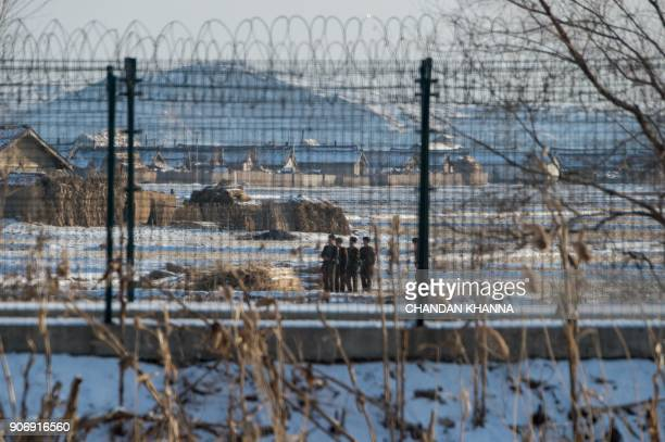 TOPSHOT In this photograph taken on January 10 2018 North Korean soldiers carry out training exercises in the North Korean town of Sinuiju opposite...