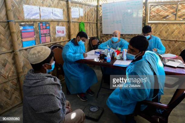 In this photograph taken on January 10 doctors from Médecins Sans Frontières examine a Rohingya Muslim refugee infected with diphtheria at the MSF...