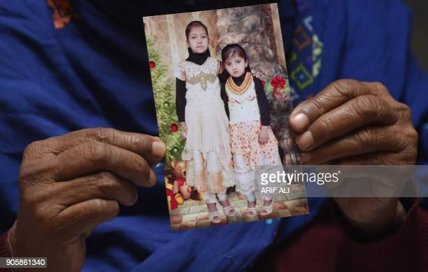 TOPSHOT In this photograph taken on January 13 the Pakistani grandmother of Liaba who was found raped and murdered in July 2017 holds a photograph of...