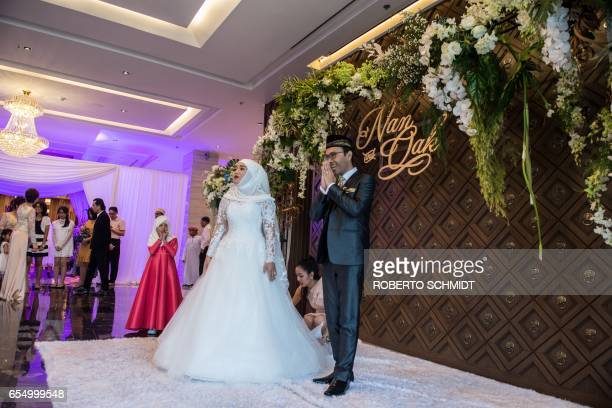 In this photograph taken on January 15 a newlywed couple gets ready to pose for formal portraits during their wedding reception at the Al Meroz hotel...