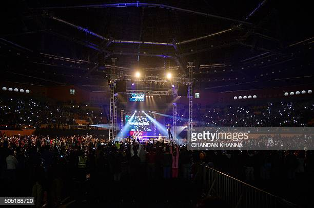 In this photograph taken on January 15 wrestler Roman Reigns holds up the Championship Belt during the World Wrestling Entertainment Live India Tour...