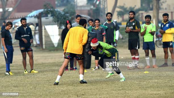 In this photograph taken on January 18 Pakistani rugby players take part in a practice session in Lahore Pakistan's women's rugby team will make...
