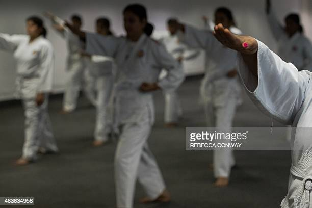 In this photograph taken on January 20 Indian policewomen practice moves during a selfdefence class in New Delhi on January 20 2015 As dawn breaks...