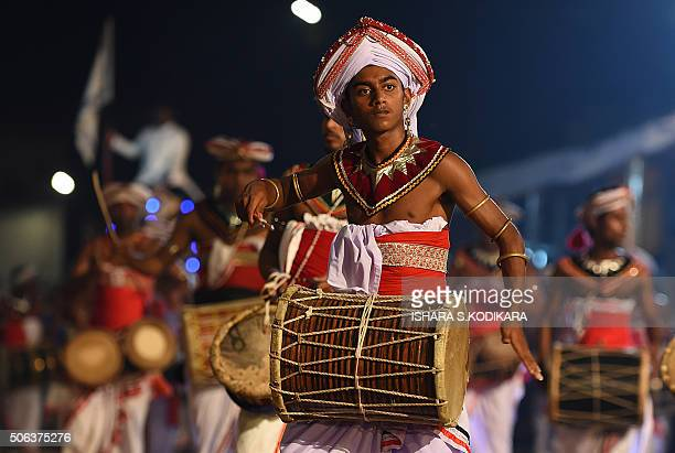 In this photograph taken on January 22 Sri Lankan Kandyan dancers perform during the annual Perahera festival at the historic Kelaniya Buddhist...