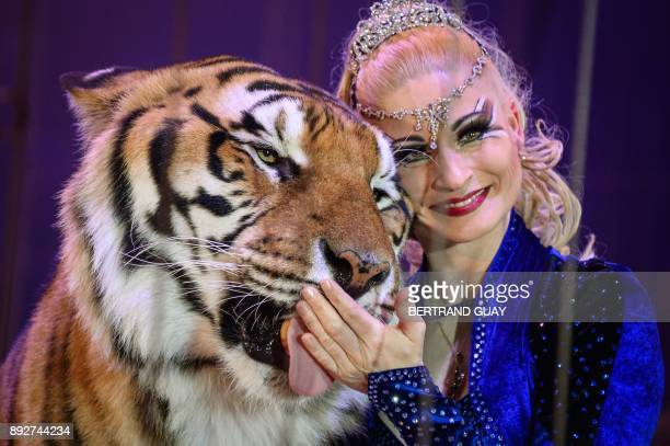 In this photograph taken on January 23 German trainer Carmen Zander poses with a tiger during the International Circus Festival in Massy The City of...