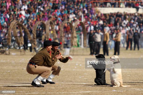 In this photograph taken on January 26 Indian Border Security Force Dog Squad personnel take part in a march during Republic Day celebrations in...