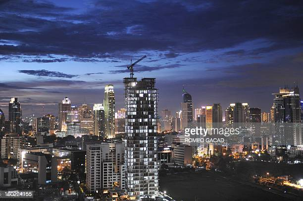 In this photograph taken on January 27 the Jakarta skyline is seen at dusk Indonesia is expected to grow 63 percent in 2013 after expanding this year...