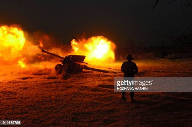 In this photograph taken on January 28 2018 an Afghan National Army soldier fires an artillery shell during an ongoing antiTaliban operation at Farah...