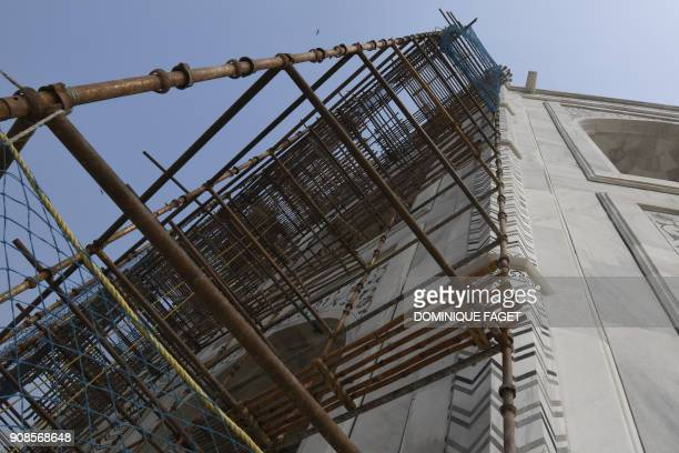 In this photograph taken on January 3 Indian labourers work amid scaffolding during conservation work at the Taj Mahal in Agra Restoration work at...