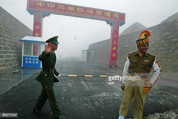 GUPTA 'INDIACHINADIPLOMACYTRADE' In this photograph taken on July 10 2008 a Chinese soldier and an Indian soldier stand guard at the Chinese side of...