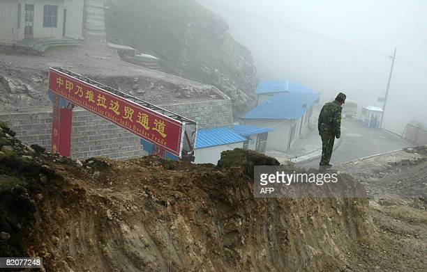 GUPTA 'INDIACHINADIPLOMACYTRADE' In this photograph taken on July 10 2008 a Chinese soldier stands guard on the Chinese side of the ancient Nathu La...