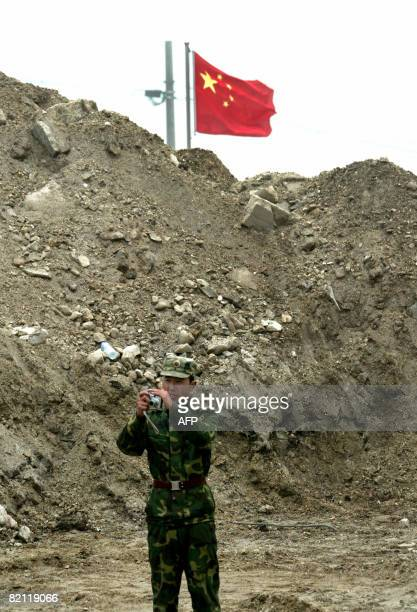 In this photograph taken on July 10 2008 a Chinese soldier stands guard on the Chinese side of the ancient Nathu La border crossing between India and...