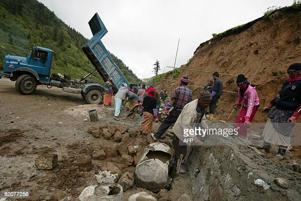 GUPTA 'INDIACHINADIPLOMACYTRADE' In this photograph taken on July 10 2008 Indian labourers works on the road leading to the ancient Nathu La border...