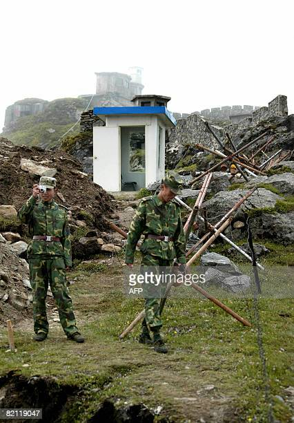In this photograph taken on July 10 Chinese soldiers stand guard on the Chinese side of the ancient Nathu La border crossing between India and China...