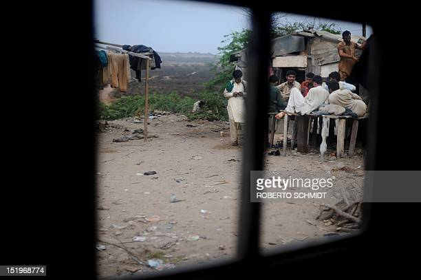 In this photograph taken on July 10 shipyard workers come together at the end of the day near rooms they rent for a fee and which they call home near...