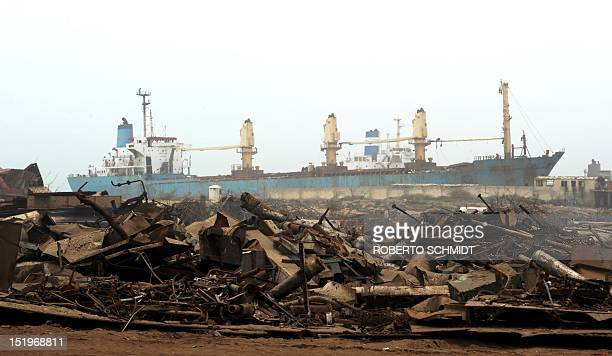 In this photograph taken on July 11 a recently beached cargo vessel waits to be dismantled in one of the 127 shipbreaking plots in Geddani some 40Kms...