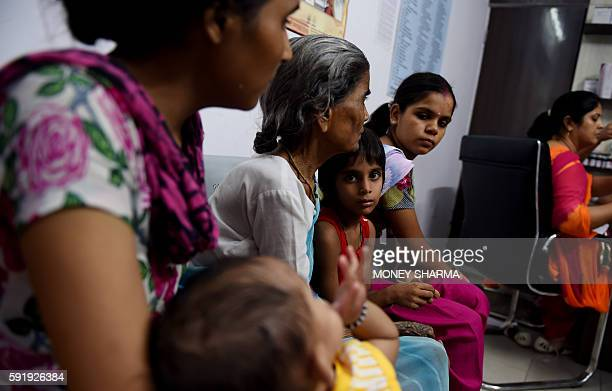 In this photograph taken on July 13 Indian patients wait for their turn to see the doctor at a Mohalla clinic in New Delhi For asthma sufferer Mohan...