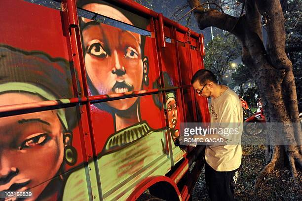 RIVET In this photograph taken on July 14 French artist Lazoo sprats graffiti mural on the side of a truck in Jakarta as part of a series in a...