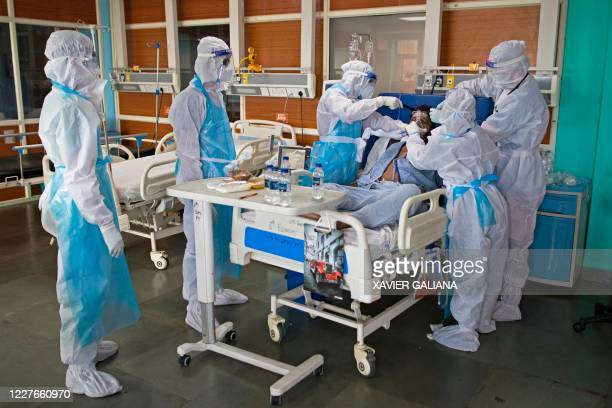 In this photograph taken on July 15 2020 doctors and nurses wearing Personal Protective Equipment suits look after a COVID19 coronavirus patient at...