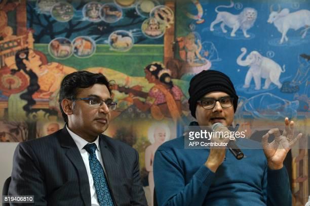 In this photograph taken on July 18 2017 Dr Sharan Srinivasan Senior Consultant Neurosurgeon looks on as his patient Abhishek Prasad speaks during a...