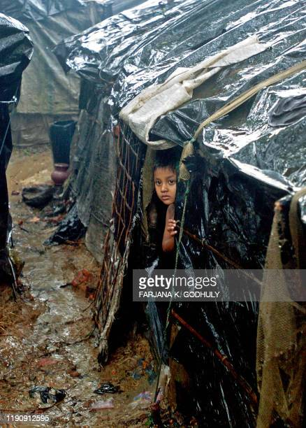 CLOTHIER BANGLADESHMYANMARREFUGEESAID In this photograph taken on July 2 2008 a Myanmar refugee child peers from a makeshift shelter at a camp in...