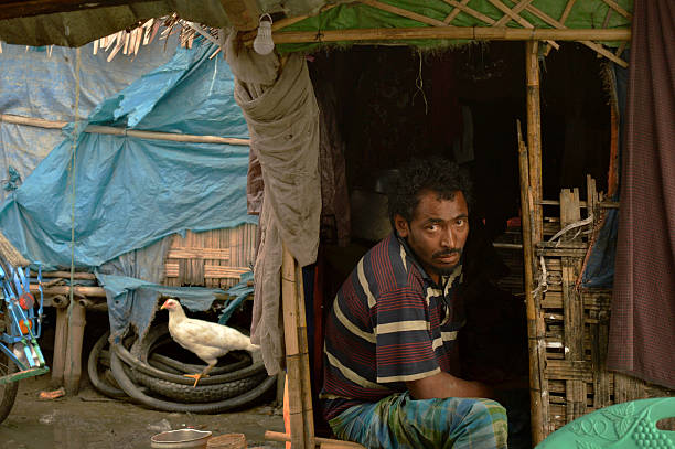 56cab89f In this photograph taken on July 2, 2016, a Muslim Rohingya man sit in  front of ...