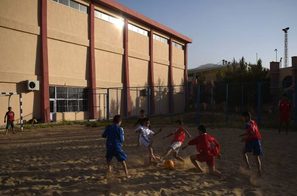 2d852c95 In this photograph taken on July 2, 2017, Afghan youths play beach football  at Ghazi stadium ...