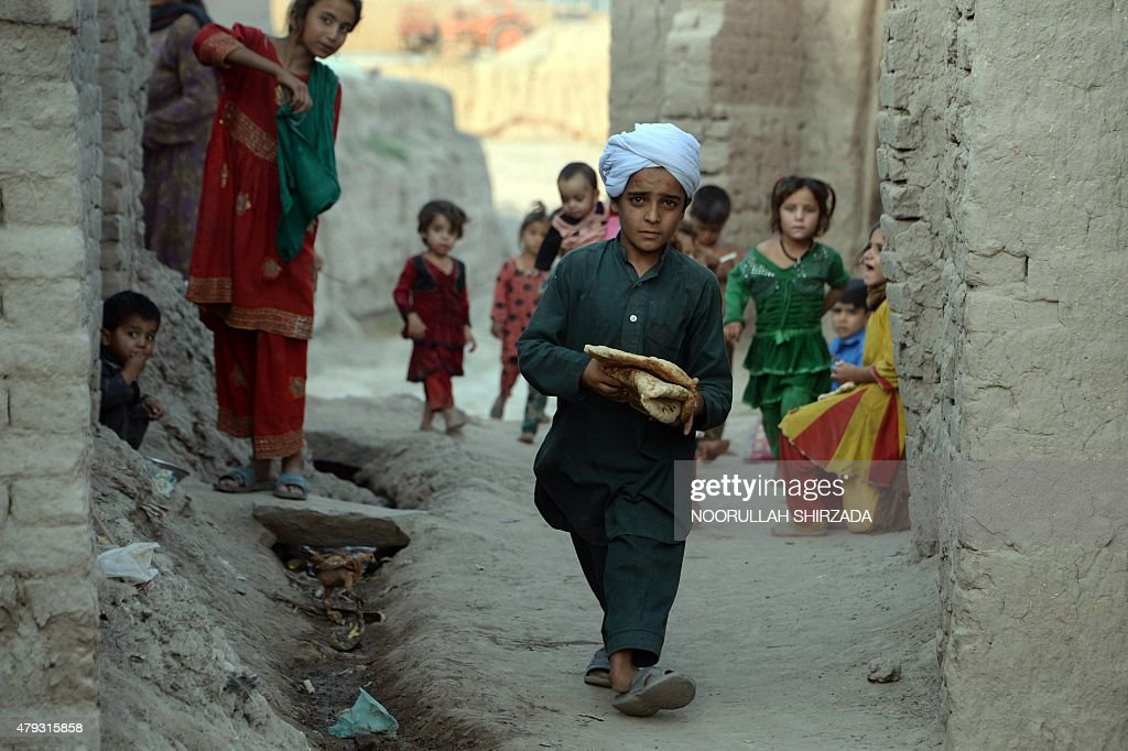 e44dabfe In this photograph taken on July 2 an Afghan youth carries bread for ...