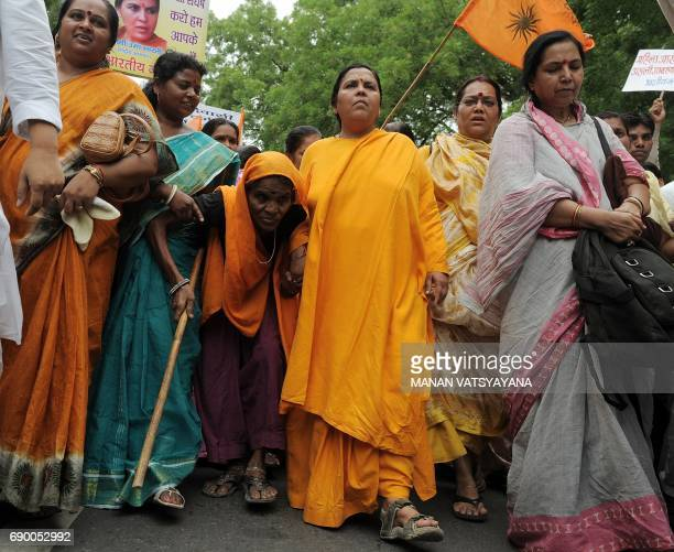 In this photograph taken on July 2 Indian Bharatiya Janshakti Party leader Uma Bharti takes part in a rally in New Delhi A special court May 30...