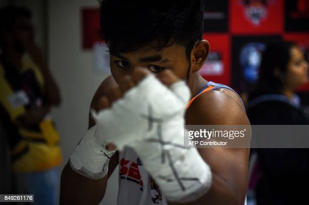 In this photograph taken on July 21 boxer Andy Chuaua with the Maratha Yoddhas team prepares before a fight during a Super Boxing League event in New...