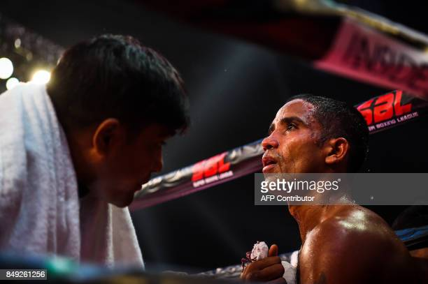 In this photograph taken on July 21 boxer Venkat Naik with the Bahubali Boxers team rests during a break in his fight at a Super Boxing League event...