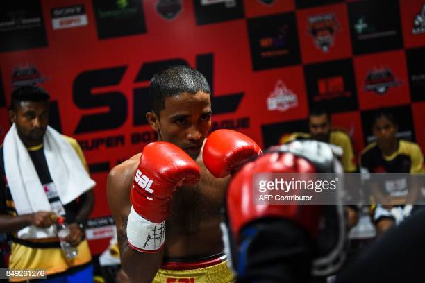 In this photograph taken on July 21 boxer Venkat Naik with the Bahubali Boxers team prepares for his fight at a Super Boxing League event in New...