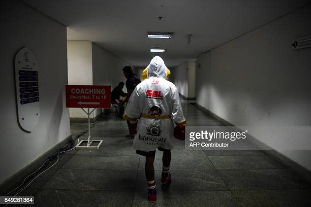 TOPSHOT In this photograph taken on July 21 boxer Venkat Naik with the Bahubali Boxers team walks towards the arena for his fight during a Super...