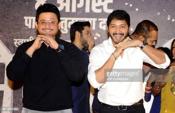 In this photograph taken on July 23 2017 Indian Bollywood actors Swapnil Joshi and Shreyas Talpade during the music launch of Marathi film 'Bhikari'...
