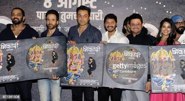 In this photograph taken on July 23 2017 Indian Bollywood film director and producer Rohit Shetty actors Tusshar Kapoor Bobby Deol Shreyas Talpade...