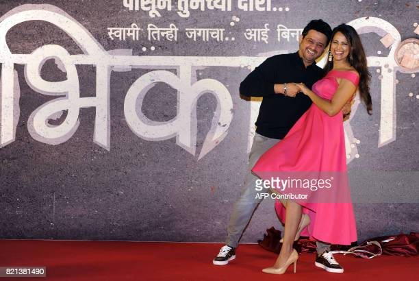 In this photograph taken on July 23 2017 Indian Bollywood Hindi and Marathi film actors Swapnil Joshi and Rucha Inamdar pose during the music launch...