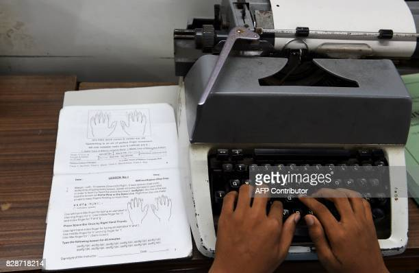 In this photograph taken on July 24 a student practices correct positioning of the fingers on a typewriter at Abhyankar's Shorthand Typing Institute...