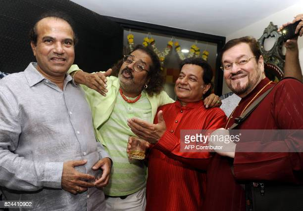 In this photograph taken on July 29 Indian Bollywood singers Suresh Wadkar Hariharan and Nitin Mukesh pose for a picture during the 64th birhday...