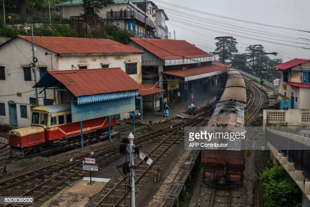 In this photograph taken on July 30 the toy train which runs between Shimla and Kalka leaves the train station in Shimla The narrowgague rail line...