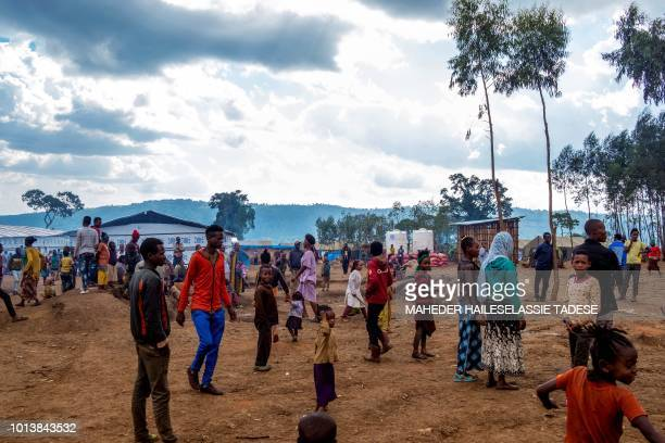 In this photograph taken on July 31 displaced Gedeo build temporary camps in the Gedeb area of Ethiopia Ethiopia's Prime Minister Abiy Ahmed's...