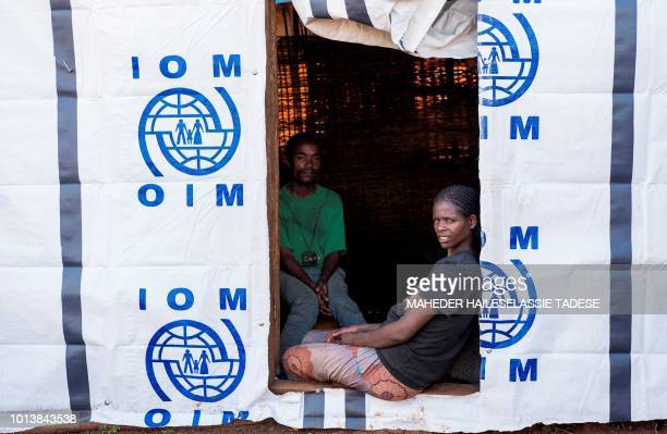 In this photograph taken on July 31 displaced Oromos look on as they sit in a temporary shelter at Banco Chelchele site in West Guji Ethiopia...