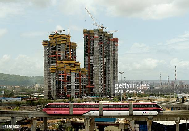 In this photograph taken on July 6 2014 the Monorail train makes its way past underconstruction buildings in Mumbai India's new government is due to...